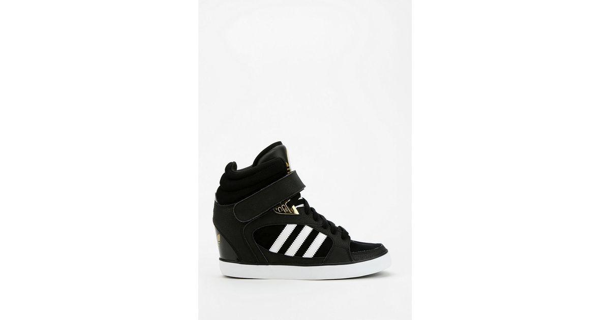 448274b8280 Lyst - Urban Outfitters Adidas Amberlight Hidden Wedge Hightop Sneaker in  Black