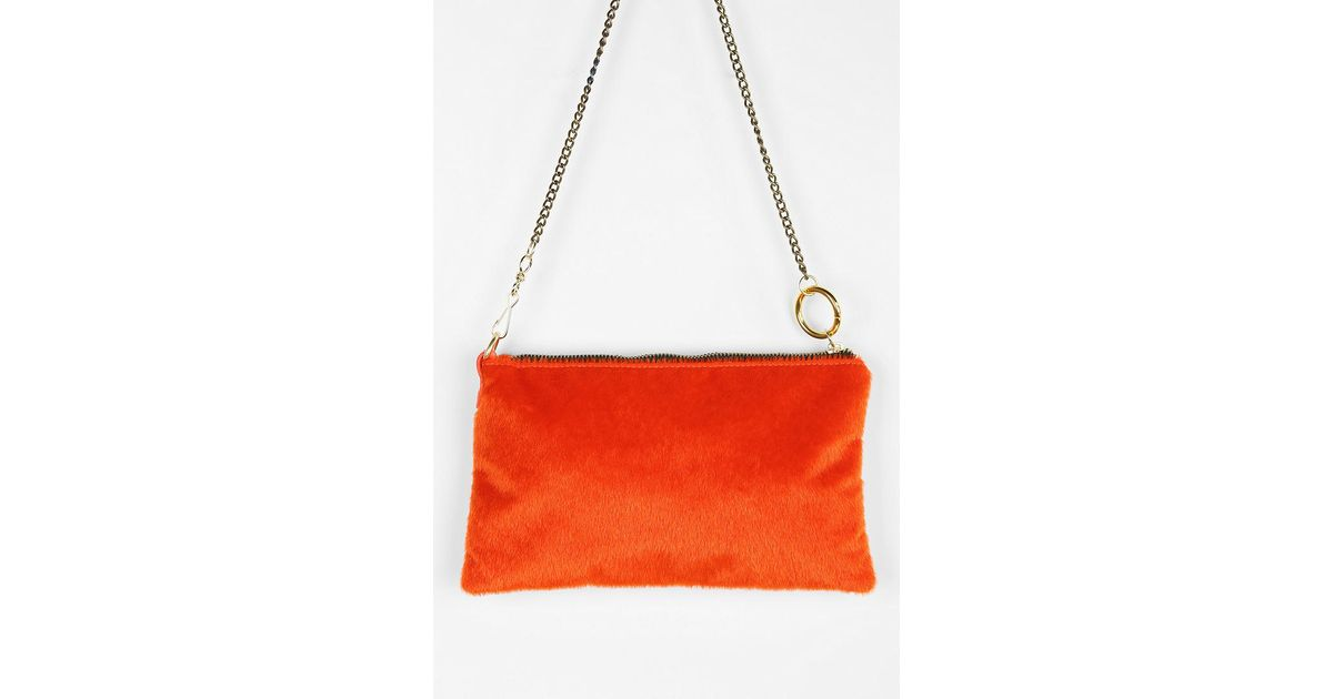 decb7763249e Lyst - Urban Outfitters Deena Ozzy Pony Oring Crossbody Bag in Orange