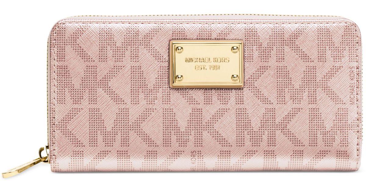 94950d28e024 Lyst - Michael Kors Signature Metallic Zip Around Continental Wallet in Pink