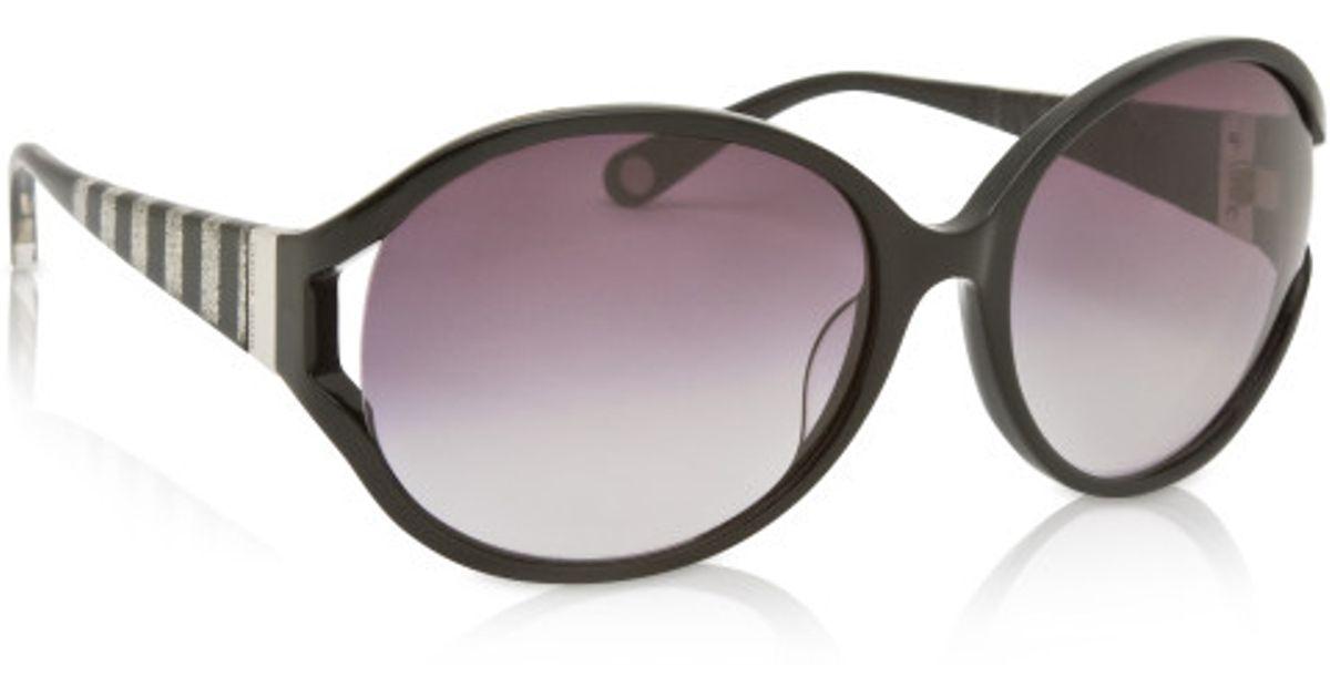 11dfa077b92 Lyst - Henri Bendel Brown White Oval Sunglasses in Brown