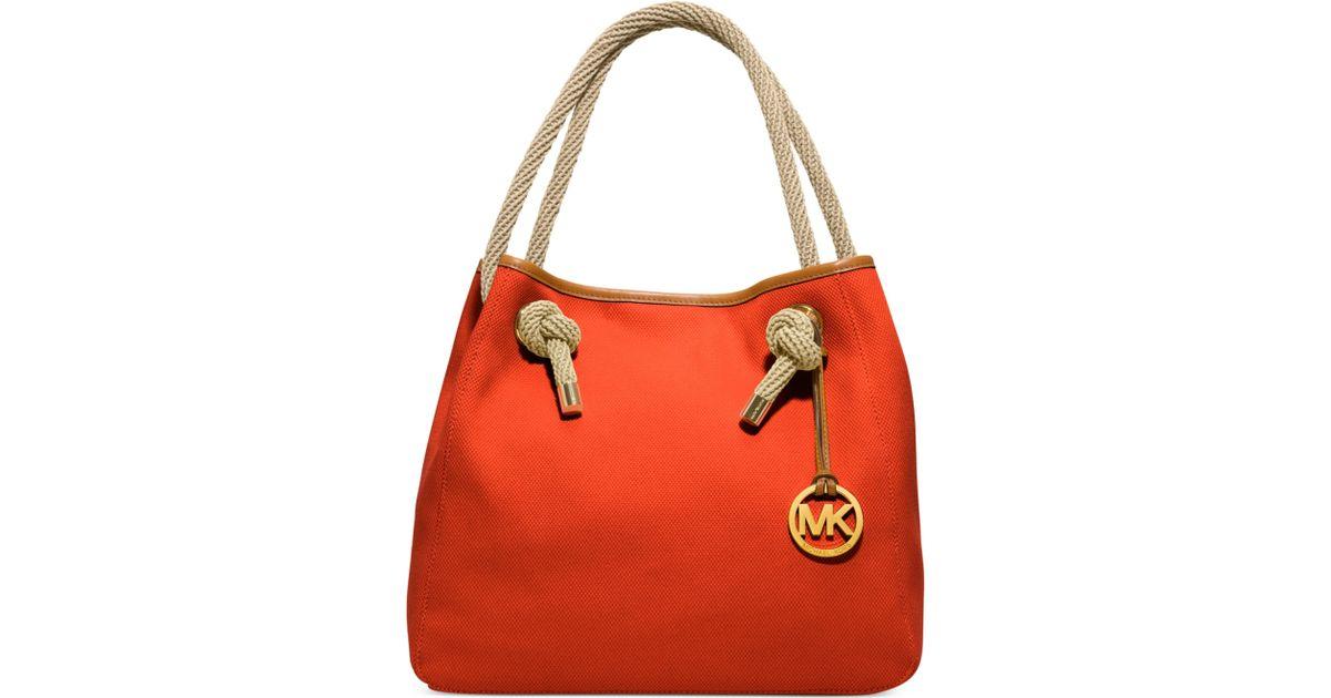 e0ebf29c42da ... denmark lyst michael kors marina large grab bag in orange 1bfc6 c688b