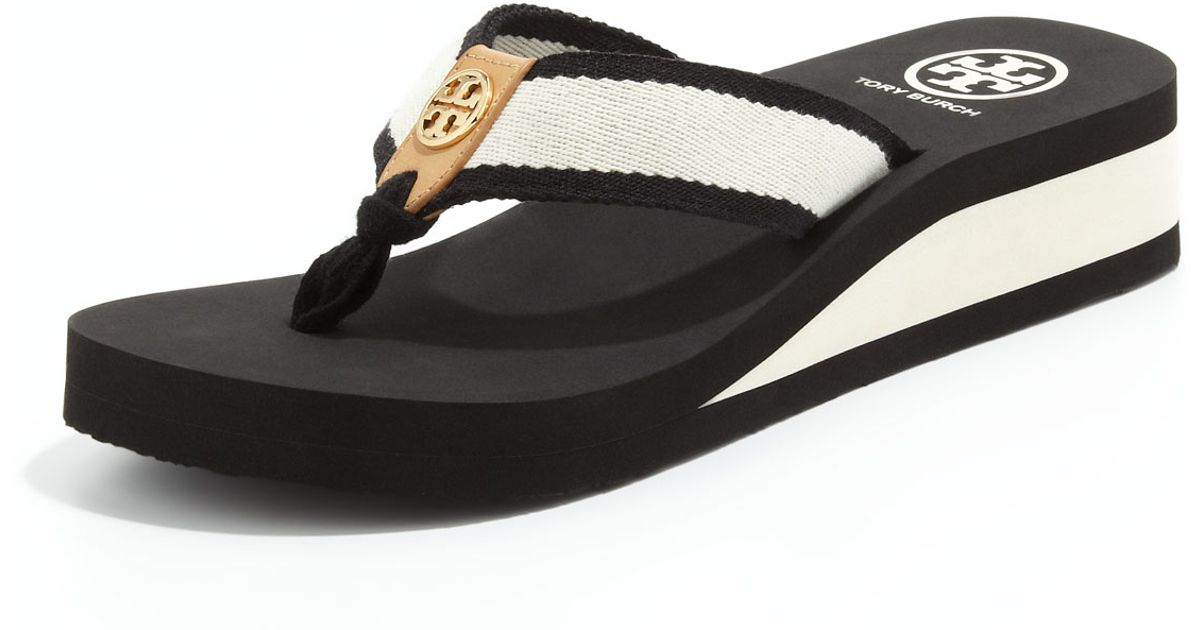 2a3cd6ab94c6 Lyst - Tory Burch Ray Rubber Wedge Flipflop Blackivoryhoney in Black