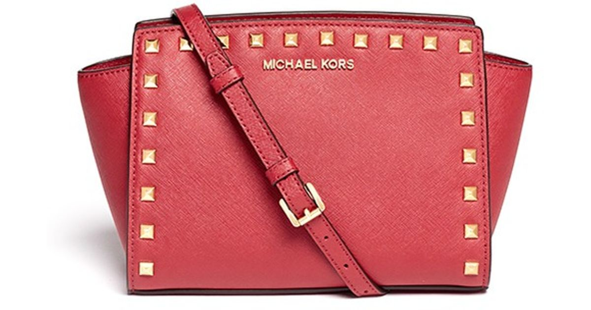 5a546cf3cc8f Lyst - Michael Kors  selma  Mini Stud Saffiano Leather Messenger Bag in Red