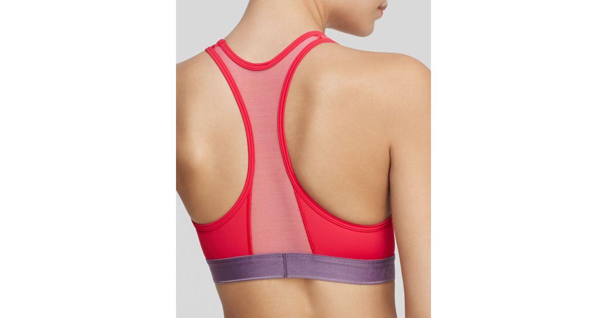 4a2571ac76 Lyst - Calvin Klein Sports Bra - Flex Motion Racerback Medium Impact   qf1083 in Pink