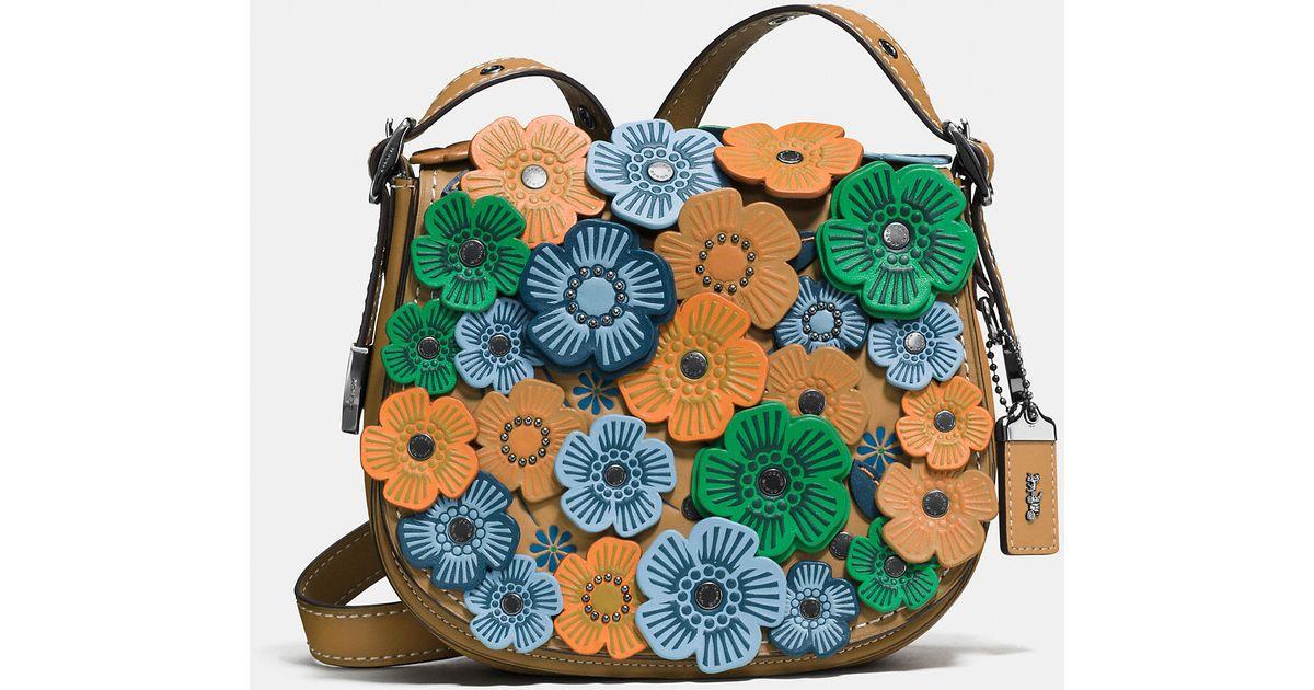 20abe2b06b83 Lyst - COACH Tea Rose Applique Saddle Bag 23 In Leather