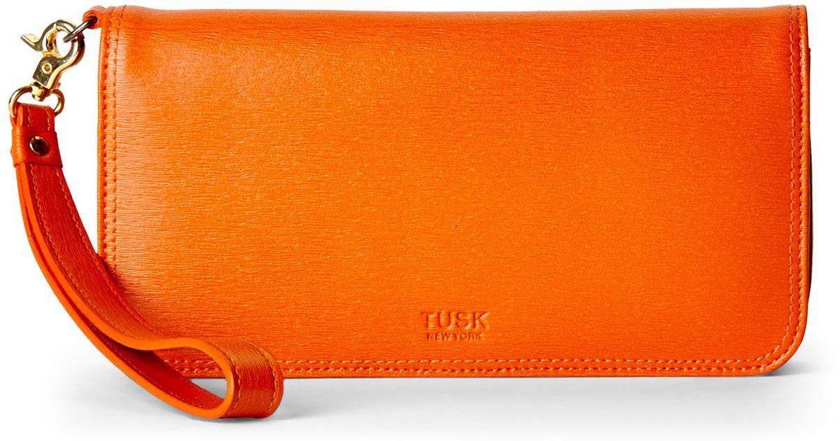 42f9100c0f957 Lyst - Tusk Orange Large Smartphone Wristlet Wallet in Orange