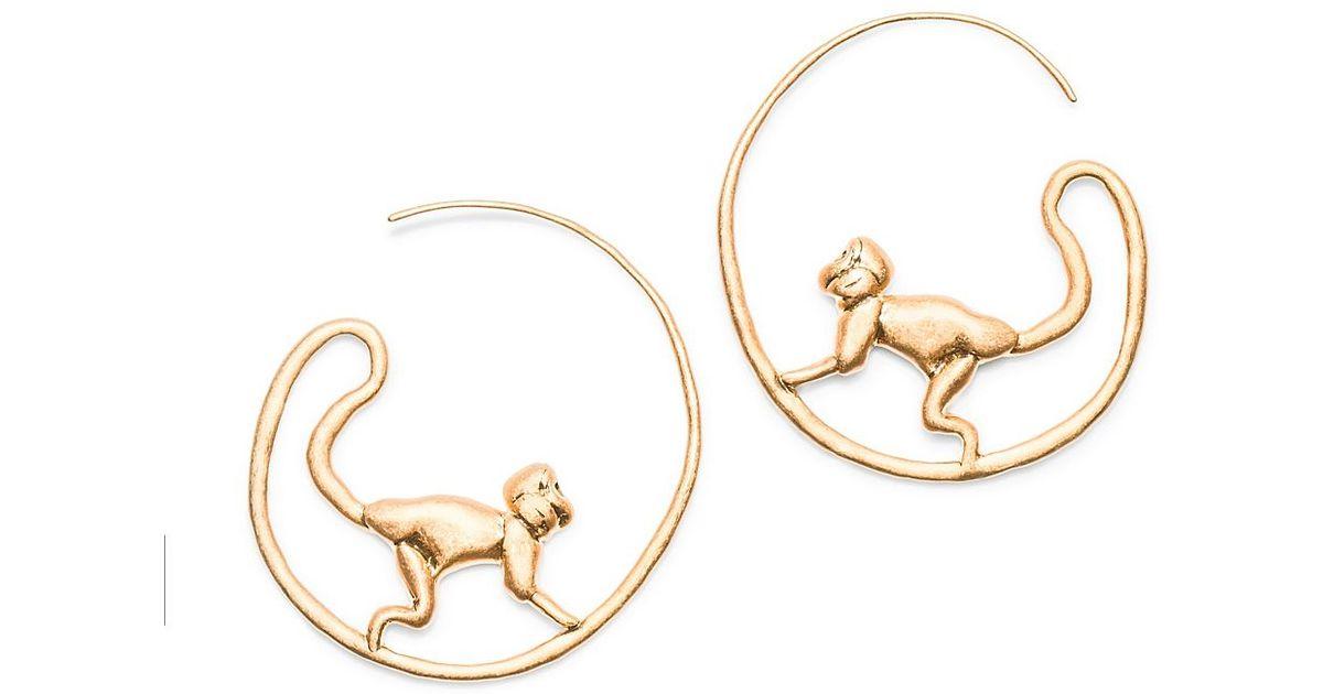 Lyst - Tory Burch Monkey Hoop Earring in Metallic