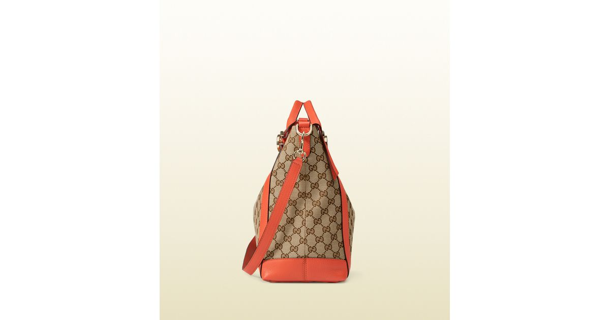 5be83693c7034 Lyst - Gucci Miss Gg Original Gg Canvas Top Handle Bag in Orange