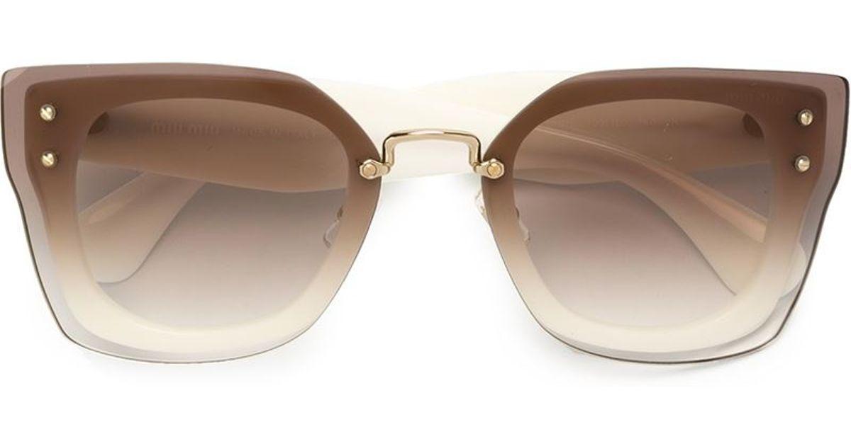 e5991841dc99 Lyst - Miu Miu  reveal  Sunglasses in Brown