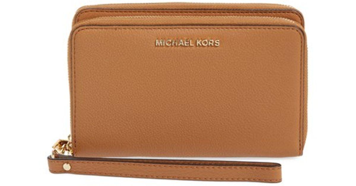 f2ece2496b51 Lyst - MICHAEL Michael Kors  adele  Leather Wristlet in Metallic