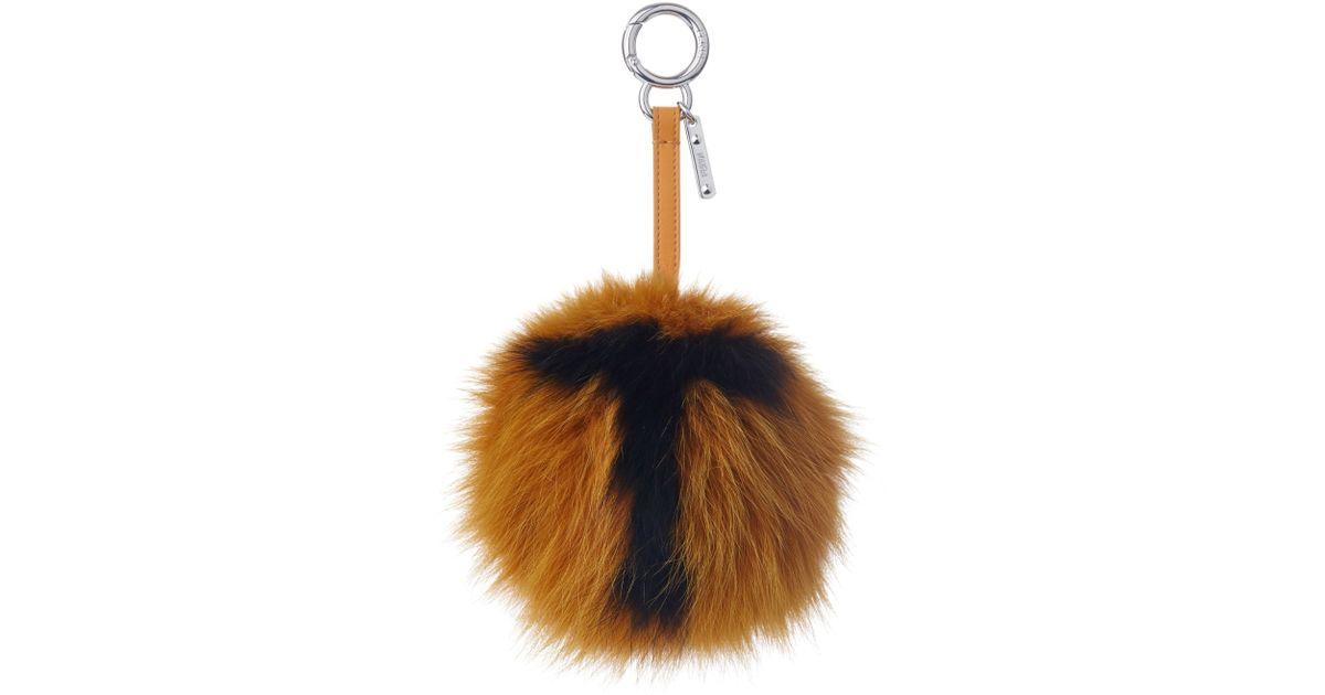 Lyst - Fendi T-letter Pompom Fox-fur Bag Charm in Orange b0f7c3416086
