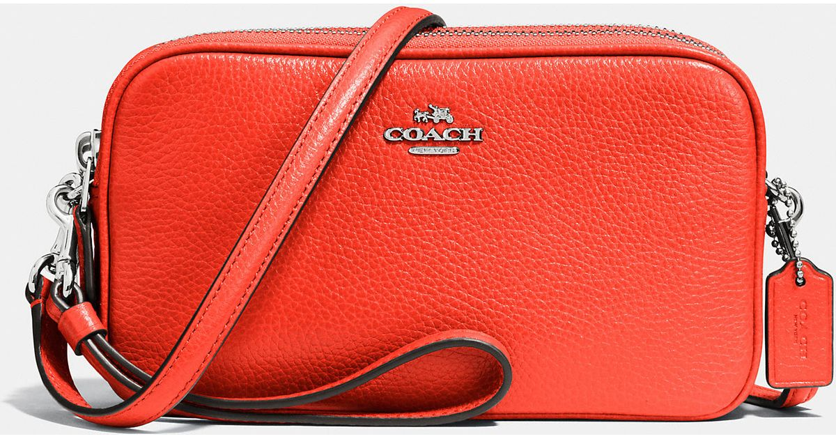 f5ff1ba1645c Lyst - COACH Crossbody Clutch In Pebble Leather in Orange