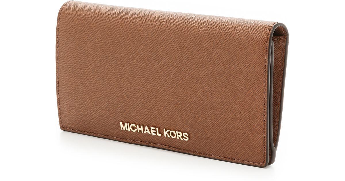 ebe399ca1cdd Lyst - MICHAEL Michael Kors Jet Set Travel Large Slim Wallet in Brown