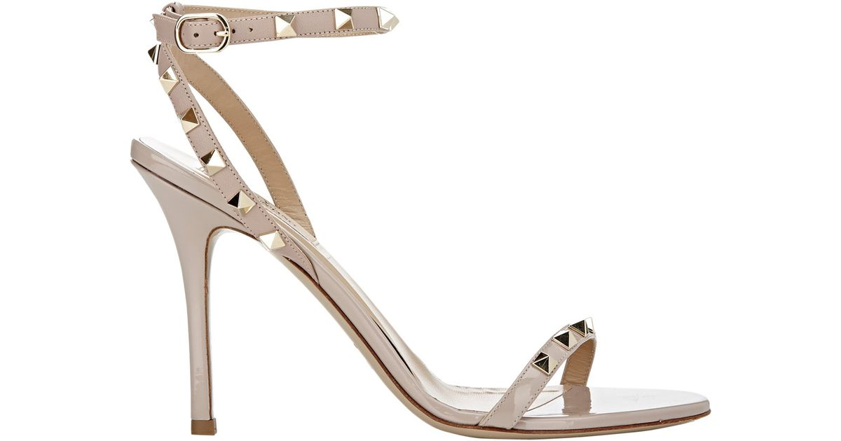 f0c7758fc409 Lyst - Valentino Women s Rockstud Ankle-strap Sandals in Natural