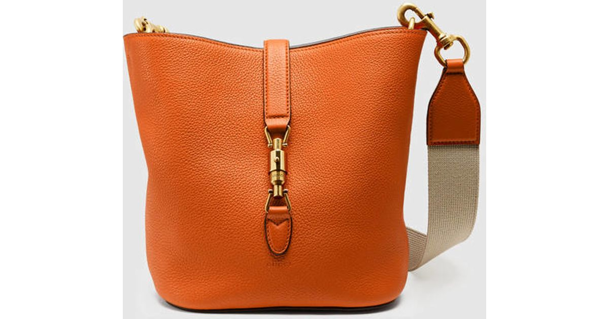 d93d29905ff Lyst - Gucci Jackie Soft Leather Bucket Bag in Orange