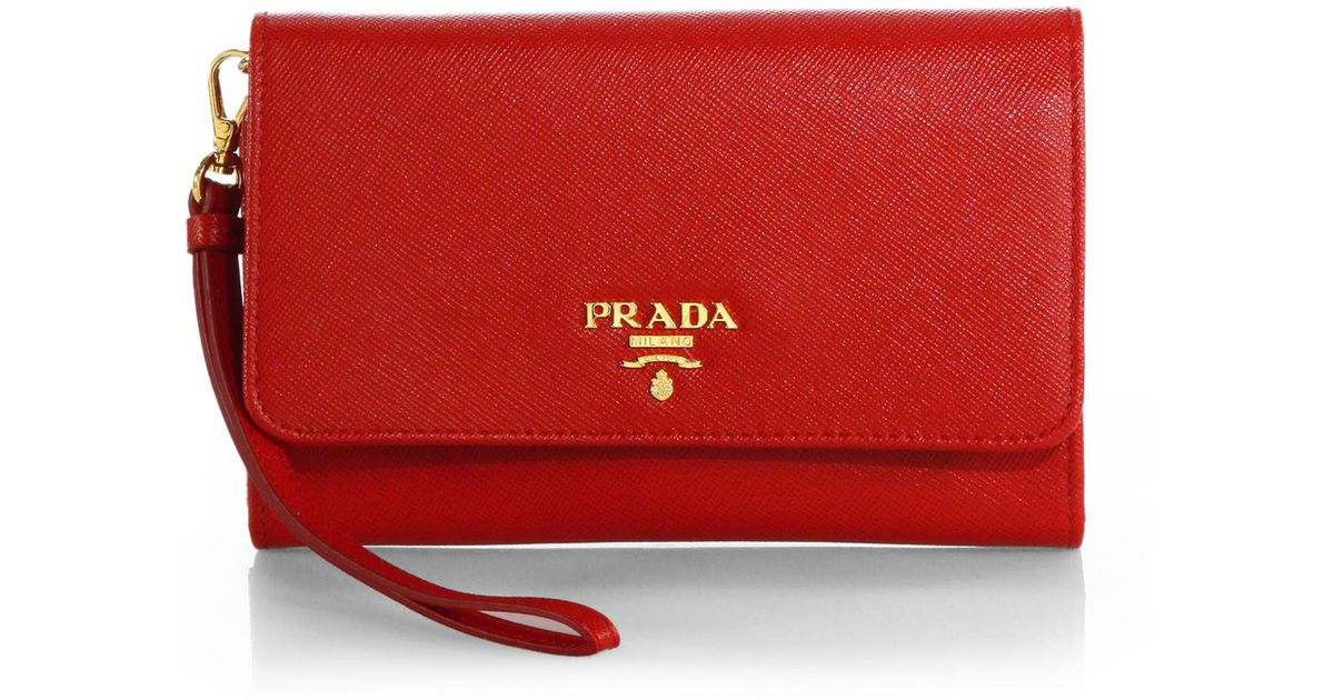 137cfd813083 ... 50% off lyst prada saffiano phone wallet with strap in red 85d32 4055d