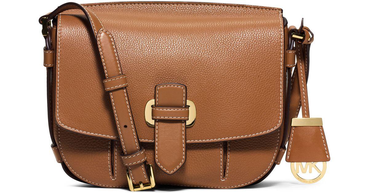 66b8d7db6884 ... greece lyst michael michael kors romy medium leather messenger bag in  brown 2a80e ff376