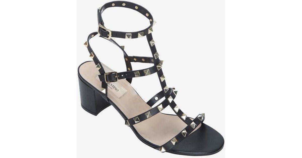 1b36bd7eba2 Lyst - Valentino Rockstud Gladiator Mid Chunky Heel Sandal Black in Black