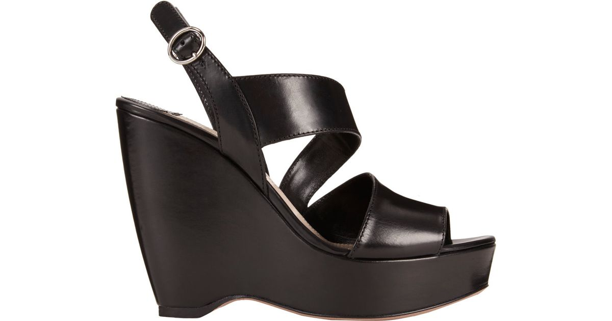 aa8959ad48d Prada Asymmetric Platform Wedge Sandals in Black - Lyst