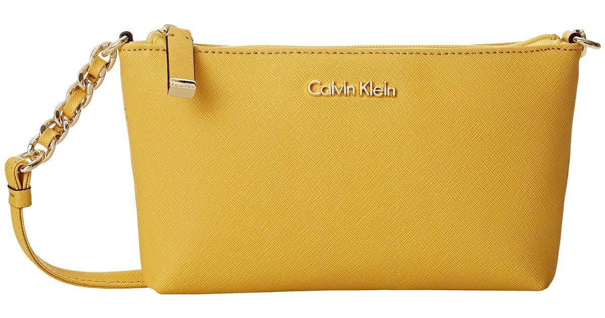 999104ec938 Calvin Klein Saffiano Crossbody in Yellow - Lyst