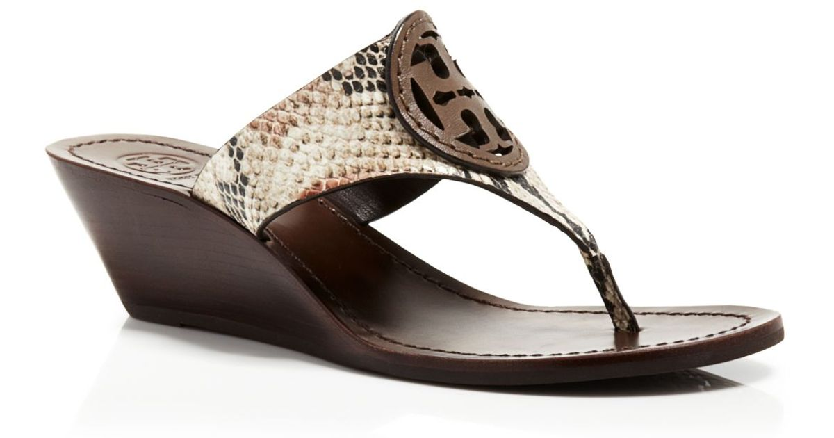 ea07ace5cf0af Lyst - Tory Burch Slide Wedge Thong Sandals - Louisa Snake-Embossed Logo