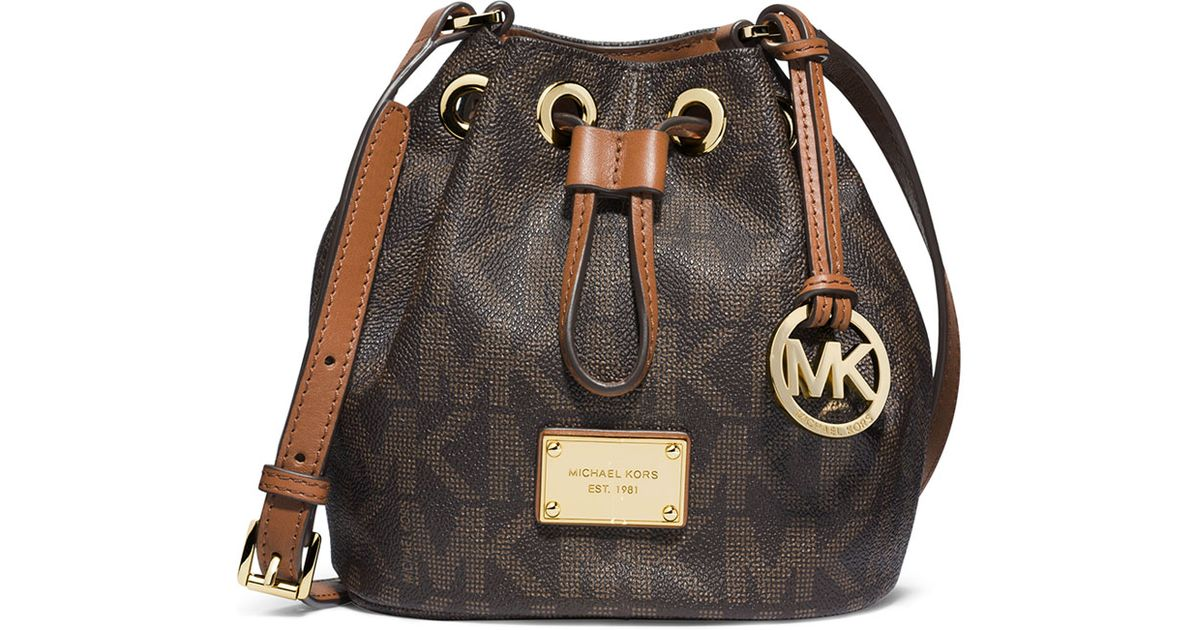 bcb2b43f66ad ... inexpensive lyst michael michael kors jules logo drawstring crossbody  bag in brown 716db 9227d