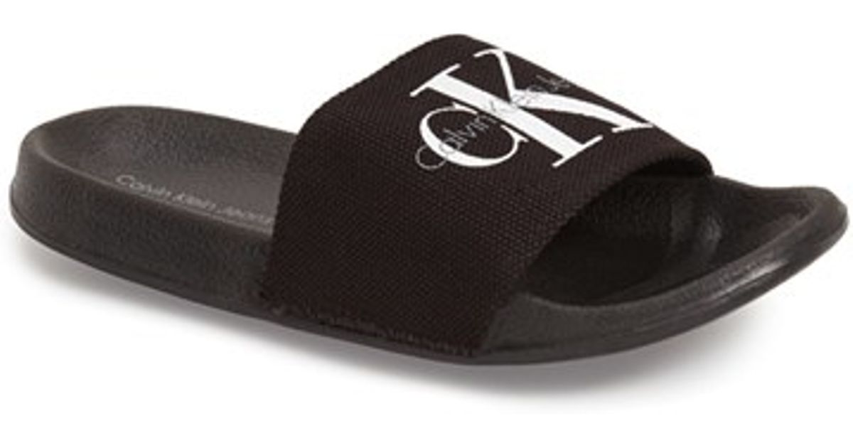 50202074b74be Lyst - Calvin Klein Viggo Logo-Detail Cavas Slides in Black