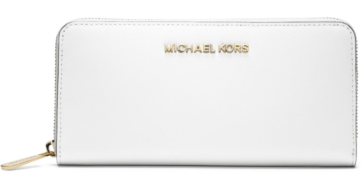 4d6280495405 Michael Kors Jet Set Travel Saffiano Leather Continental Wallet in White -  Lyst