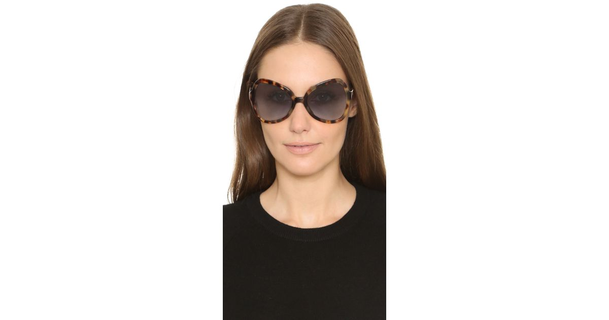 2484ef121f42a ... sale lyst prada butterfly sunglasses in blue f150d 745e1 discount prada  butterfly frame sunglasses spr 18i black ...