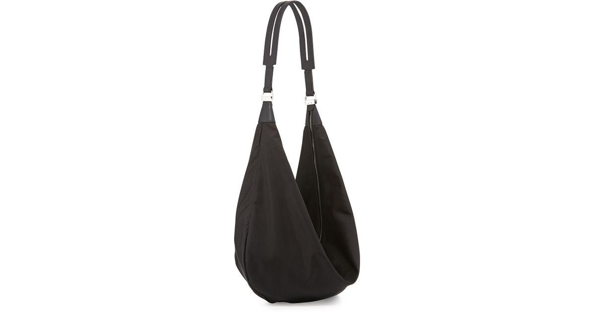 6e6e0f69cd59 Lyst - The Row Sling 15 Nylon Hobo Bag in Black