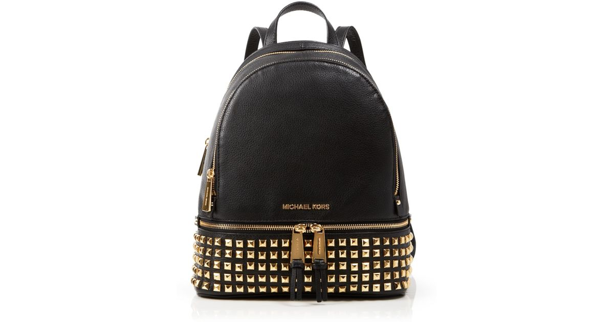 9a88a7f8fdce ... 50% off lyst michael michael kors small rhea zip studded backpack in  metallic 02d91 61f32 ...