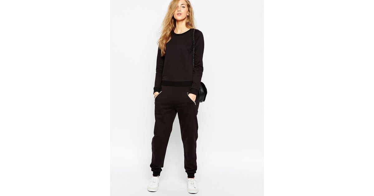 0bbd0b45e3c Lyst - ASOS Easy Fit Jersey Jumpsuit With Long Sleeves And Zip Pocket -  Black in Black