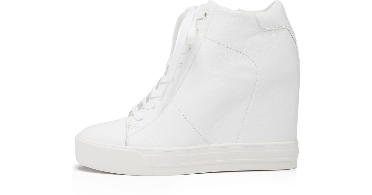 Lyst - DKNY Ginnie Wedge Sneakers in White f5d20d99e