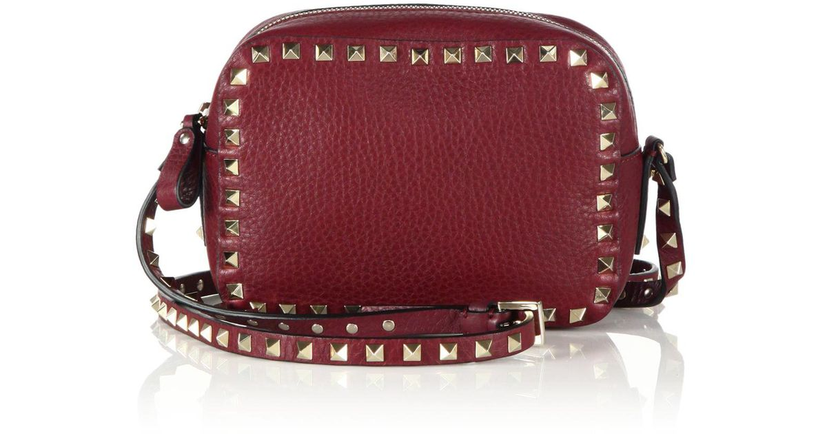 25f905abbbcd Lyst - Valentino Rockstud Pebbled Leather Camera Crossbody Bag in Red