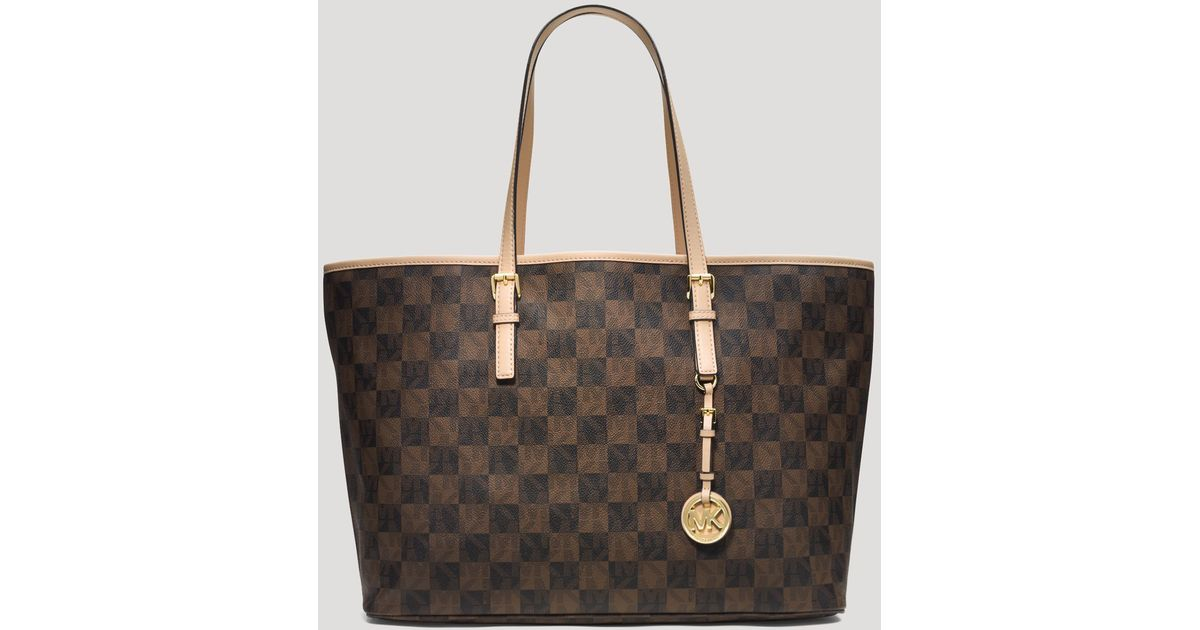 ... authentic lyst michael michael kors tote jet set travel checkerboard  logo medium in brown eef5d 5b4bf db67ab7741d51