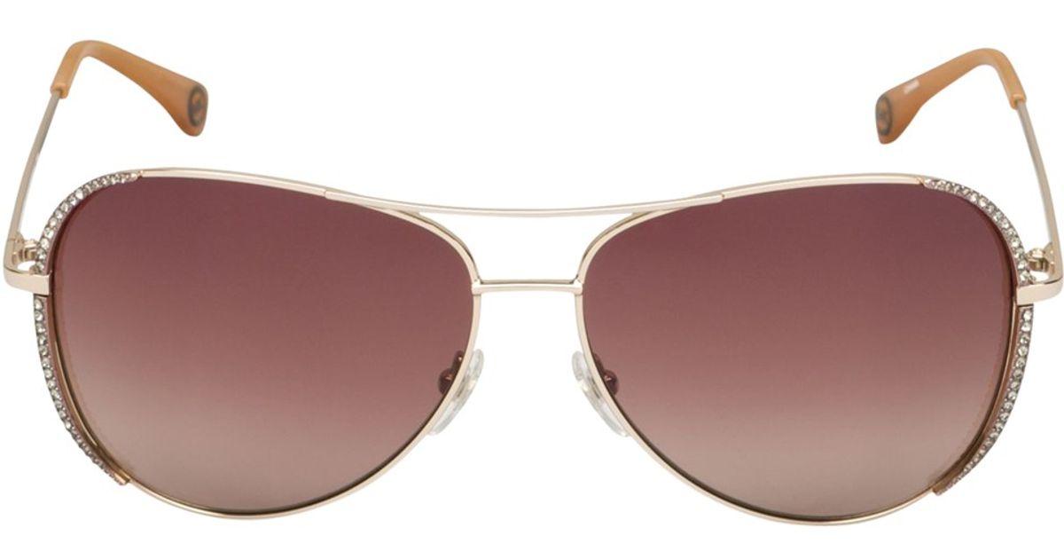 7867a5d55c60 Michael Kors Sadie Crystal Aviator Sunglasses in Metallic - Lyst
