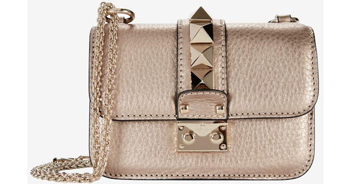 9b60a2dca71 Valentino Mini Rockstud Lock Shoulder Bag: Rose Gold in Pink - Lyst