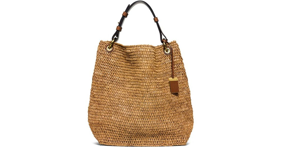 476908d2e8ba ... closeout lyst michael kors large santorini raffia shoulder bag in brown  1ea56 da50f