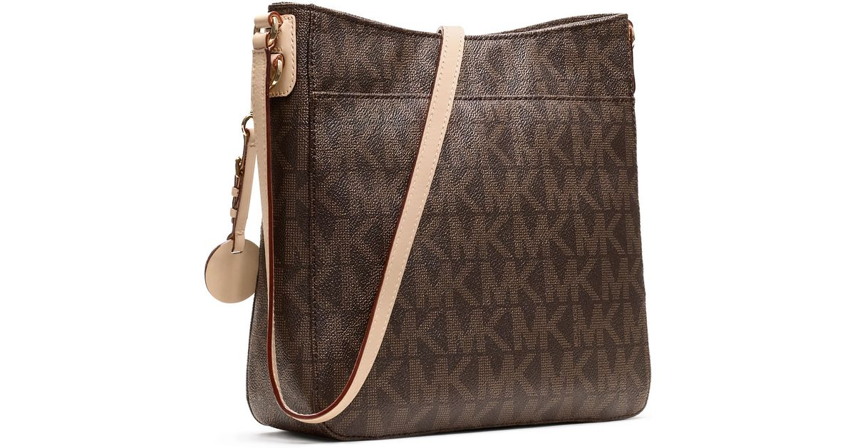 7454b07c1d3121 MICHAEL Michael Kors Jet Set Large Travel Logo Messenger Bag in Brown - Lyst