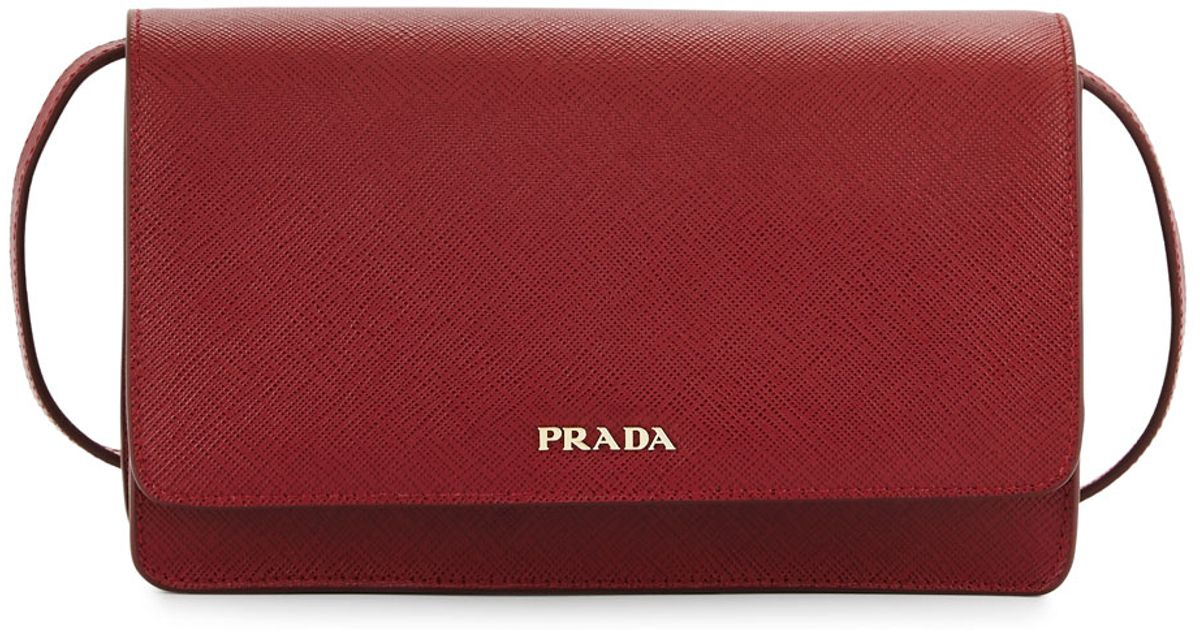 9923fe97672c ... discount code for lyst prada saffiano mini crossbody bag in red 119a3  82c63