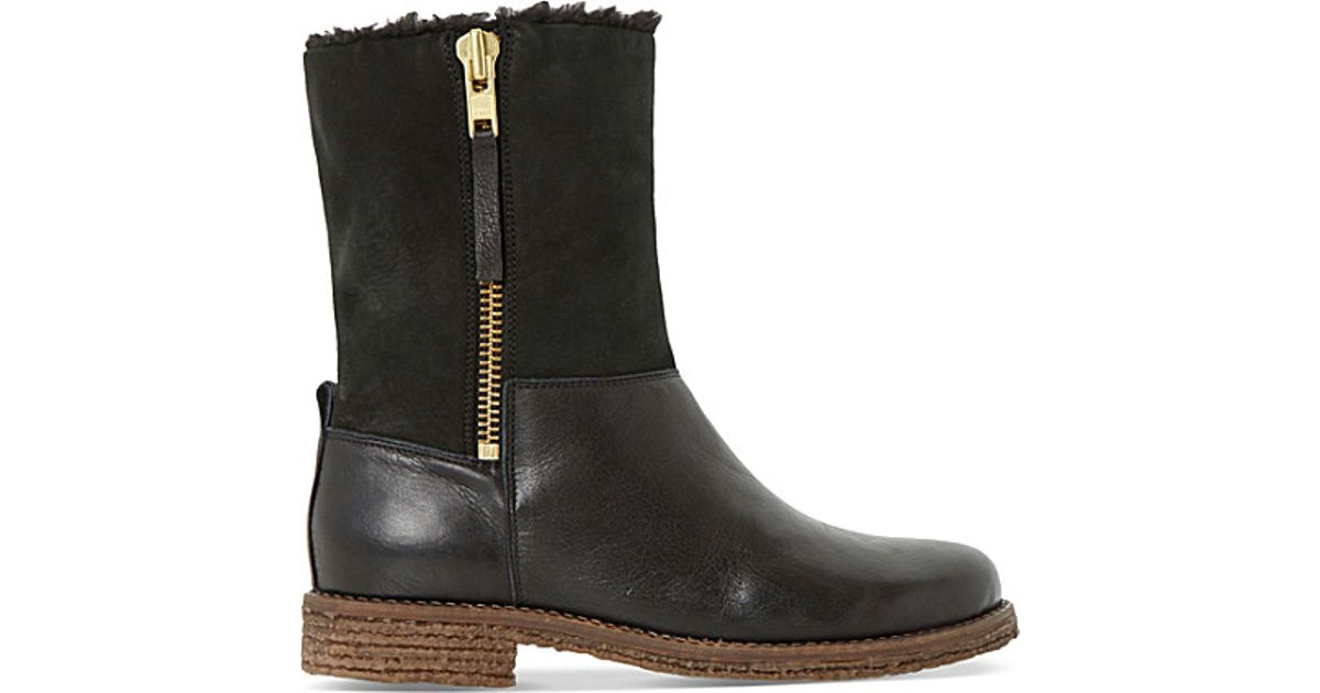 dune faux fur lined leather boots in black lyst