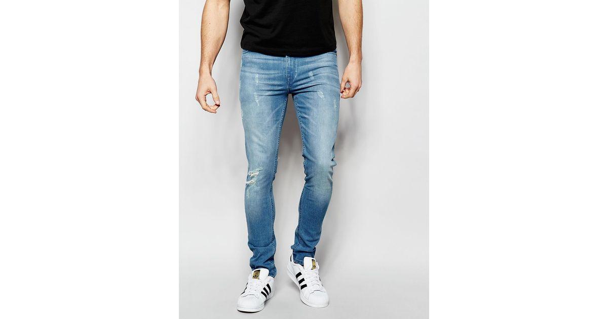 asos super skinny jeans with abrasions blue in blue for men lyst. Black Bedroom Furniture Sets. Home Design Ideas