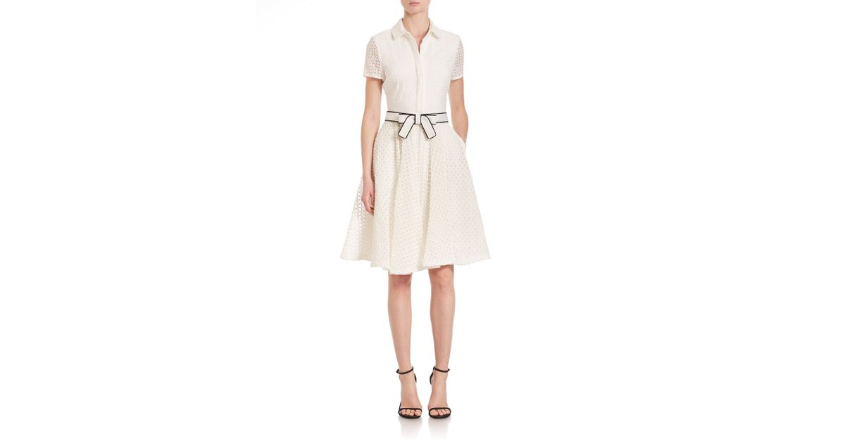 White short sleeve shirt dress.