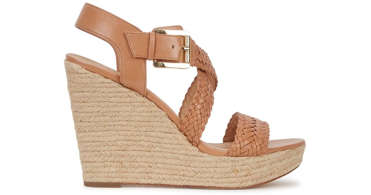 3c1b060caee Michael Kors - Natural Giovanna Woven Leather Wedge Sandals - Lyst