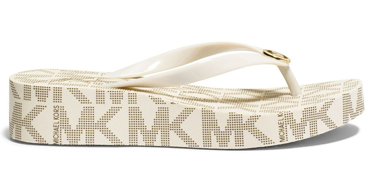 745748a0d37 Lyst - MICHAEL Michael Kors Flip Flop Wedge Sandals - Bedford Logo in White