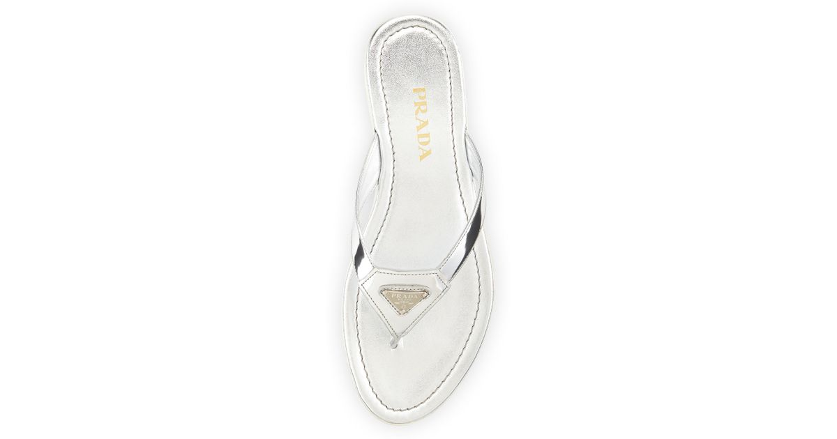 7e55d13e5839 Lyst - Prada Patent Leather Logo Thong Sandal in Metallic