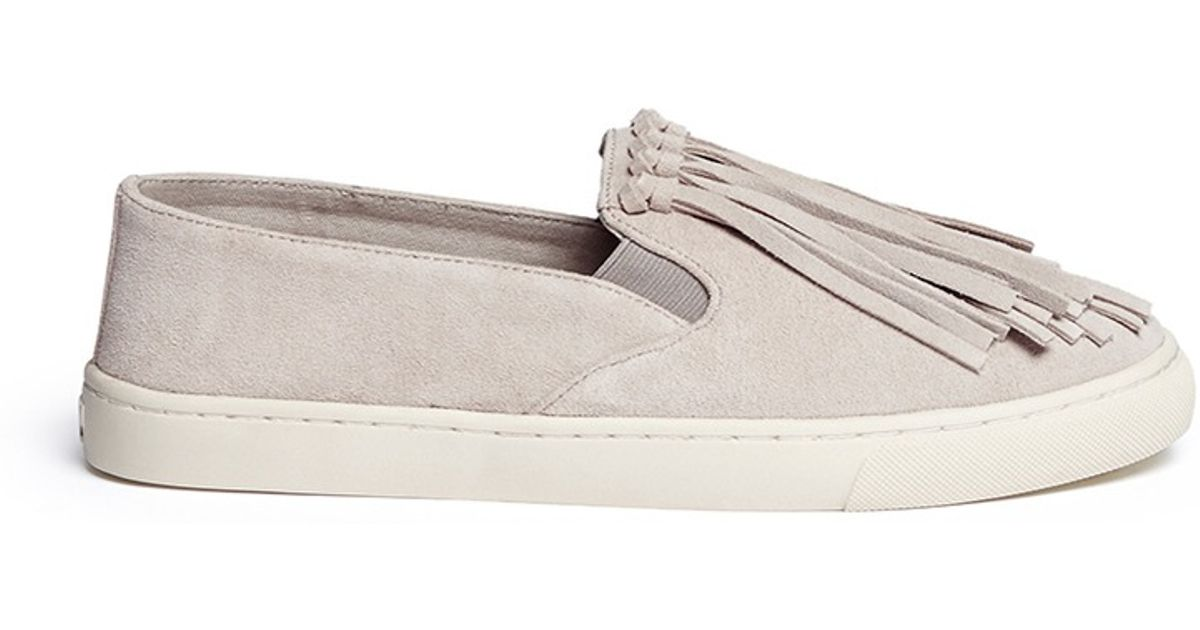 d44927cc293a Lyst - Tory Burch Fria Fringed Suede Slip-Ons in Gray