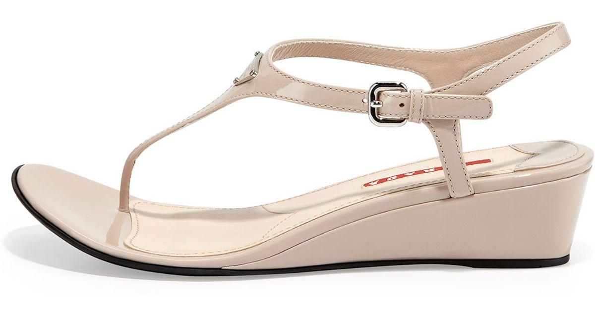 e97f7e4340b Lyst - Prada Patent Demi-Wedge Thong Sandal in Natural
