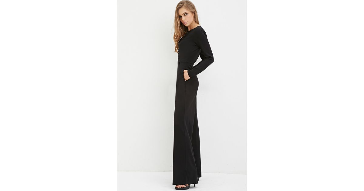 07ca3f11aac Lyst - Forever 21 Studded Jumpsuit in Black