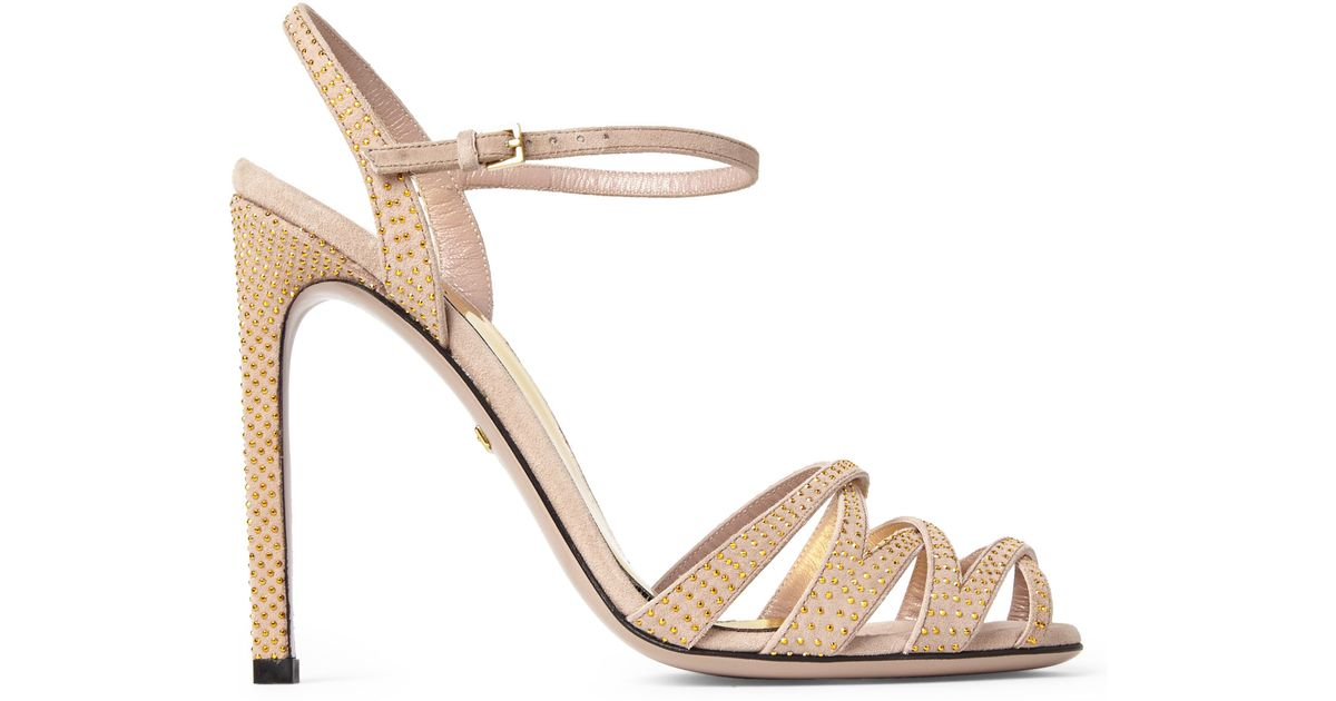 c377511e7711 Lyst - Gucci Nude   Gold Fleur Studded Sandals in Natural